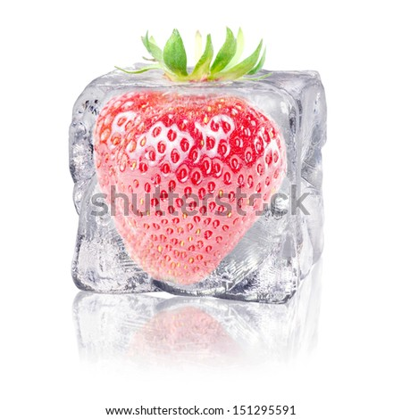 a strawberry enclosed in an ice cube before white background - stock photo