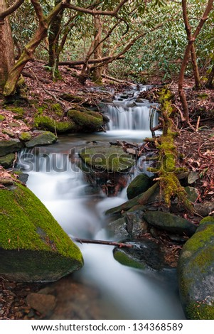 A stream cascades over rocks in the Smoky Mountains of Tennessee. - stock photo