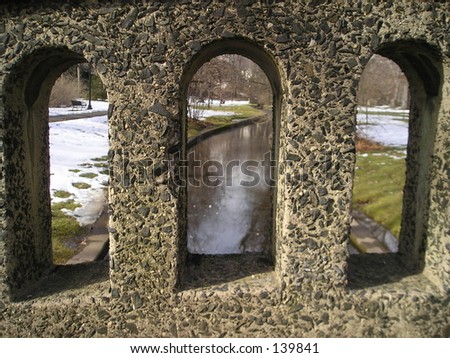 A stream seen through a bridge