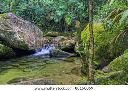A Stream with a small waterfall in a tropical rainforest - stock photo