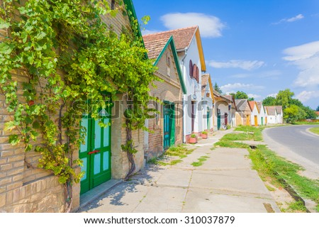 A street from Villany, Baranya county, Hungary full with wine cellars, wine yards and wineries. - stock photo
