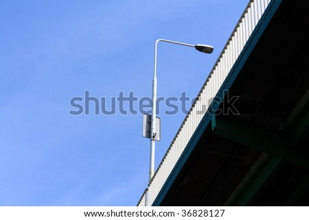 A street lamp on a bridge. - stock photo