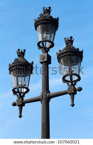 A street lamp on blue sky background in Barcelona, Spain - stock photo
