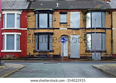 A street of boarded up derelict houses awaiting regeneration in Liverpool UK - stock photo