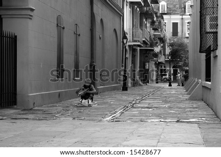 A street performer packs her trumpet at the end of a lonely day - stock photo