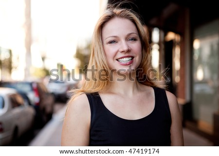 A street portrait of a beautiful business woman