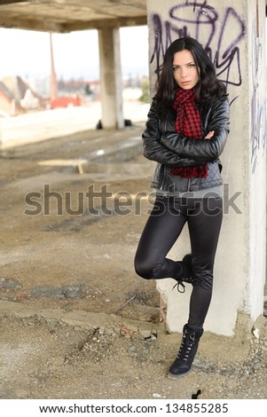 A street portrait of a beautiful young woman - stock photo