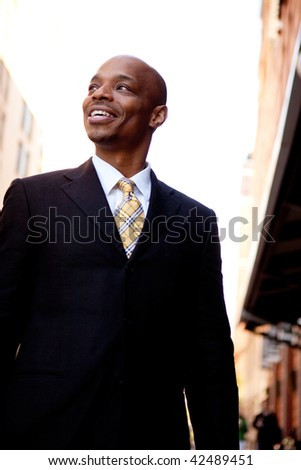 A street portrait of a business man walking on a sidewalk
