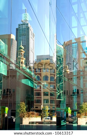 A street scene, reflected in the glass facade of a nearby inner-city office building, Melbourne, Australia - stock photo