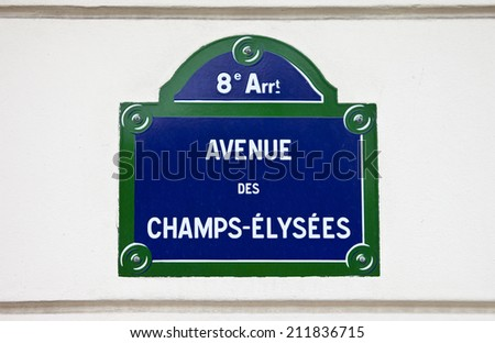 A Street sign for Avenue des Champs-Elysees in Paris. - stock photo