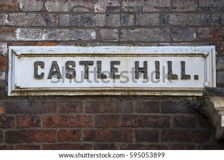 A street sign for Castle Hill in the historic city of Lincoln, in the UK.