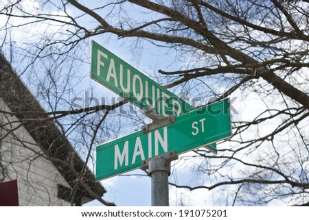 "A street sign that says, ""Fauquier"" and ""Main"" in The Plains, Virginia. The Plains is located in Fauquier County Virginia. - stock photo"