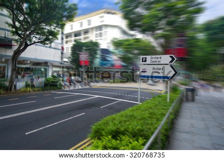 A Street View Of The Orchard Road In Singapore With The Motion Blur. The Orchard Road Longs 2.2 Kilometers And One Of The Major Tourist Attractions And The Entertainment Hub Of Singapore - stock photo