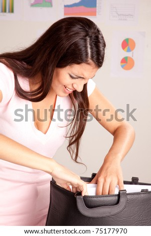 A stress forgetful business woman looking in her briefcase - stock photo