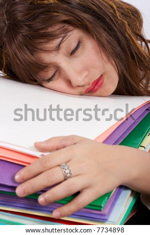 A stressed businesswoman on her office desk