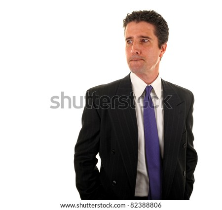 A stressed out businessman worries about the economy and his financial future at his job. - stock photo
