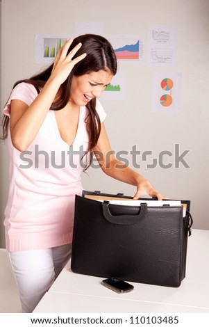 A stressed women who is looking for a lost document - stock photo