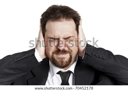 A stressed young man with closed eyes - stock photo