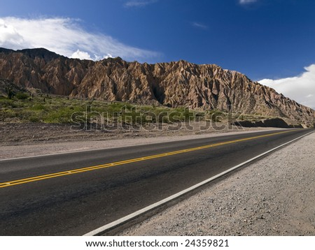 A stright road across the northwest desert. Argentina. - stock photo