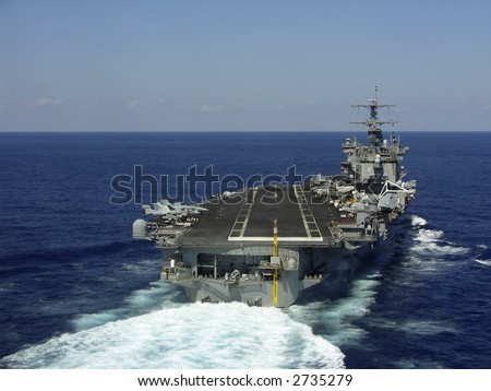 A striking image of a nuclear powered aircraft carrier - stock photo