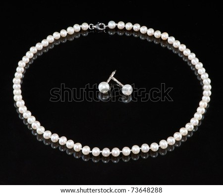 A string of pearls and earrings - stock photo