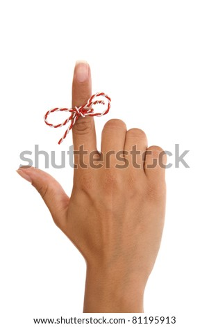 A string on woman finger.... remember something... don't forget, isolated on white background - stock photo