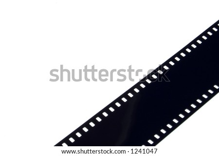 A strip of 35mm film used as a borde in the corner of the image. Use as a background or use isolated. - stock photo
