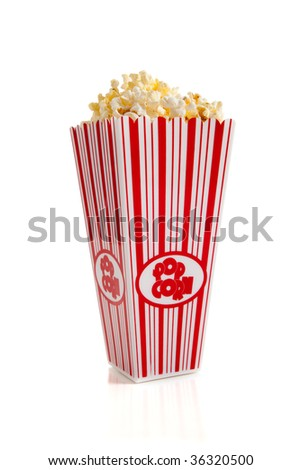 A striped container of movie popcorn on a white background - stock photo