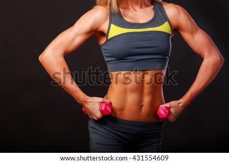 A strong, athletic girl with fitness equipment
