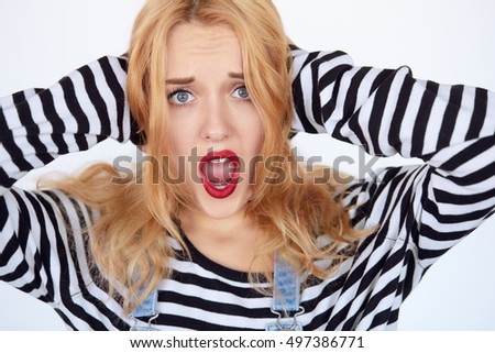 A strong image of a very upset and emotional woman screaming and holding arms on ears. Isolated on white.