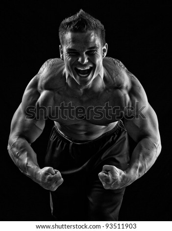 A strong, young, adult male, flexing. Black and white.