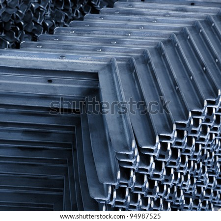 A stuck of textured metal details - stock photo