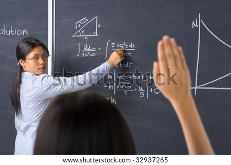 A student asking to the teacher about mathematics - stock photo