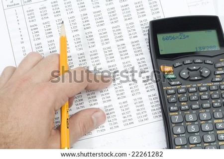 A student doing his homework - stock photo