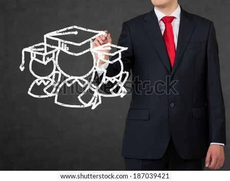 A student drawing a graduation sketch - stock photo