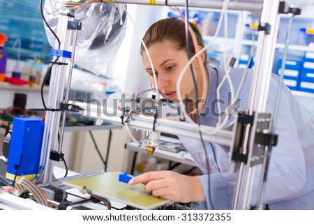 A student girl print prototype on 3D printer - stock photo