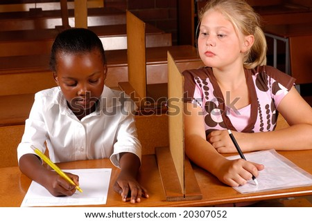 A student trying to cheat on the exams - stock photo