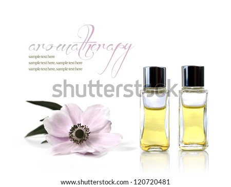A studio macro of aromatherapy oils and flower against white background. Copy space. - stock photo