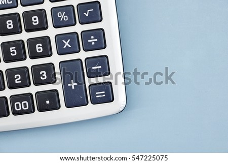 A studio photo of a business calculator