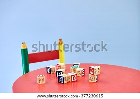 A studio photo of a childs table and chair - stock photo