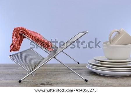 A studio photo of a dish rack - stock photo