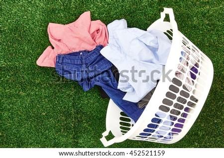 A studio photo of a laundry washing basket - stock photo