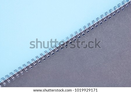 A studio photo of a notebook pad