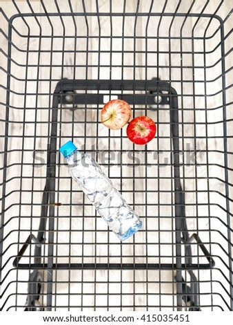 A studio photo of a shopping trolley - stock photo