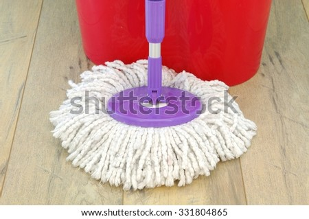 A studio photo of a spinning mop - stock photo