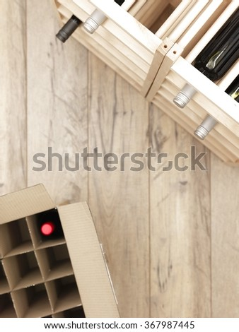 A studio photo of a wooden wine rack - stock photo