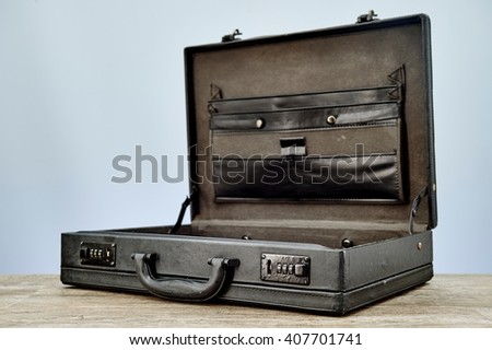 A studio photo of an old leather briefcase - stock photo