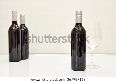 A studio photo of bottled red wine - stock photo