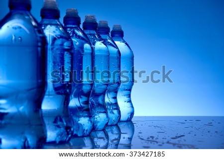 A studio photo of bottled water up close - stock photo