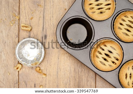 A studio photo of christmas fruit mince pies - stock photo